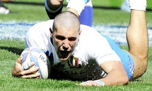 Italy's Giovanbattista Venditti scores a try during their 13-6 Six Nations win against Scotland