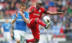 Wigan Athletic's James McCarthy and Youssouf Mulumbu of West Brom Albion