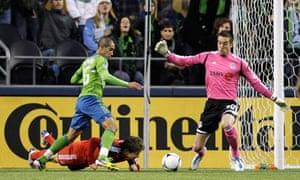 David Estrada scores for Seattle Sounders past Toronto FC's Milos Kocic. MLS