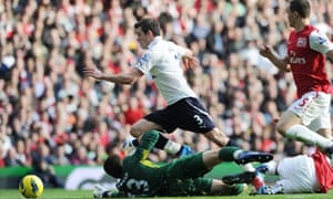 Tottenham's Gareth Bale is challenged by Arsenal's Wojciech Szczesny