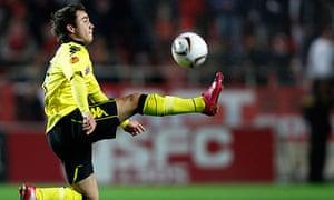 Borussia Dortmund's Mario Gotze jumps for the ball