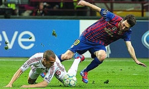 Barcelona's Lionel Messi tangles with Milan defender Djamel Mesbah at San Siro