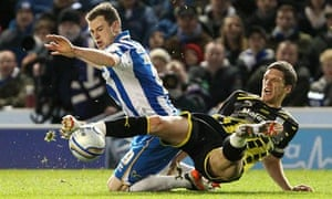 Brighton's Ashley Barnes is challenged by Cardiff's Mark Hudson