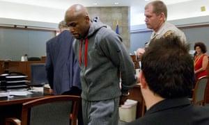 Floyd Mayweather is led away