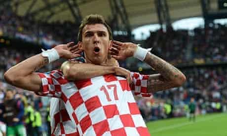 Mario Mandzukic celebratates scoring for Croatia in their 1-1 draw with Italy in Poznan
