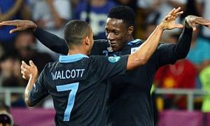 Theo Walcott and Danny Welbeck celebrate England's win against Sweden in Kiev