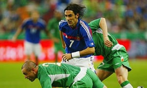 Robert Pires of France and Stephen Carr and Steve Finnan of Republic of Ireland