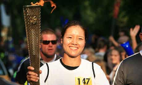 Chinese tennis player Li Na carries the Olympic flame through north London on Wednesday