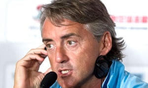 Roberto Mancini at a press conference in Beijing during his team's pre-season tour