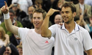 Jonathan Marray, left, and Frederik Nielsen celebrate victory in the men's doubles at Wimbledon