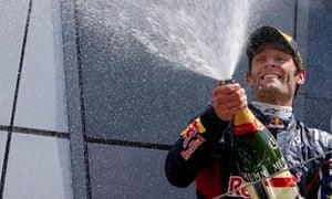 Mark Webber celebrates his victory in the British Grand Prix at Silverstone