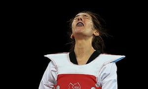 Sarah Stevenson reacts after losing her -67kg preliminary round contest against Paige McPherson