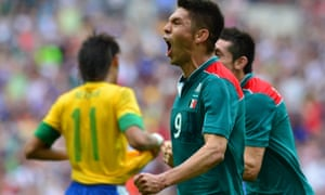 Oribe Peralta celebrates after he scored his team's second goal