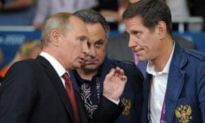 Vitaly Mutko, centre, with Russian president Vladimir Putin