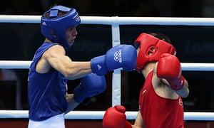Luke Campbell, left lands a punch on John Joe Nevin