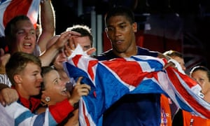 Anthony Joshua celebrates with fans