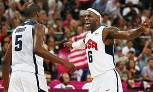 The USA's Kevin Durant and LeBron James celebrate winning Olympic basketball gold against Spain