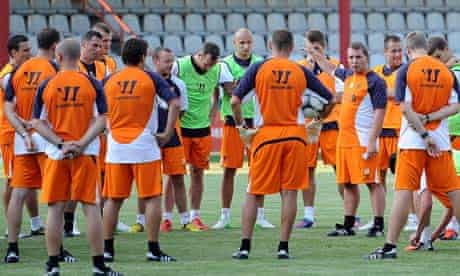 The Liverpool manager, Brendan Rodgers, talks to his players