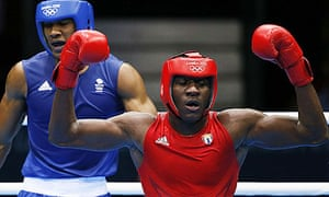 Erislandy Savon of Cuba raises his arms after his Olympic bout with Anthony Joshua