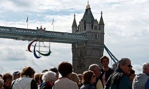 Paralympic Agitos hang from Tower Bridge in London.