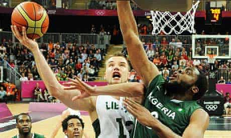Lithuania's Antanas Kavaliauskas tries to net in Olympic basketball action against Nigeria