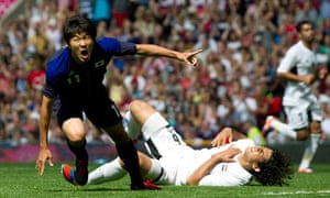 Japan's Kensuke Nagai, left, celebrates his goal as Egypt's Ahmed Hegazi lies on the pitch, Olympics
