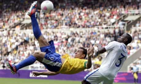 Brazil's Leandro in acrobatic action with Honduras's Maynor Figueroa, Olympic football quarter-final