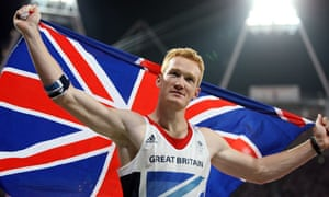 Greg Rutherford celebrates his gold medal for Great Britain in the long jump at the Olympics