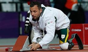 South Africa's Oscar Pistorius adjusts his starting blocks