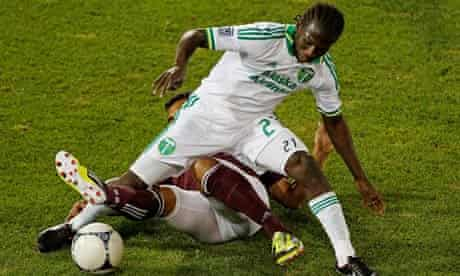 Diego Chará of the Portland Timbers controls the ball against Kamani Hill of the Colorado Rapids