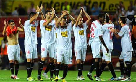 Sevilla FC's players applaud their supporters