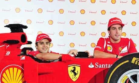Felipe Massa, left, and Fernando Alonso pose with a Lego brick-built Ferrari in Singapore