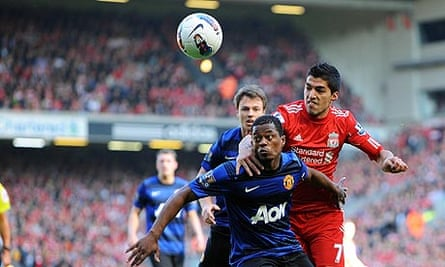 Luis Suárez, right, and Patrice Evra during their last, infamous meeting at Anfield