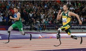 Alan Oliveira, left, of Brazil and Oscar Pistorius of South Africa in the men's T43/44 200m final