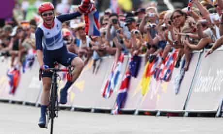 Sarah Storey celebrates winning gold in the women's individual C4-5 road race at Brands Hatch