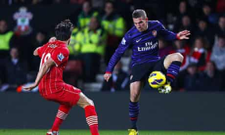 Lukas Podolski, right, looks to retain possession under pressure from Southampton's Jack Cork