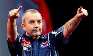 Phil Taylor of Britain reacts as he take