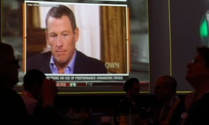 A video screen at a hotel restaurant shows Lance Armstrong