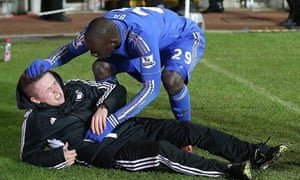 Chelsea's Demba Ba checks on the ballboy Charlie Morgan after the boy had clashed with Eden Hazard.