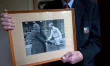Sharp holds his photograph of him meeting prime minister Harold Macmillan before the game