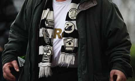 A Swansea City supporter before the FA Cup tie against Arsenal