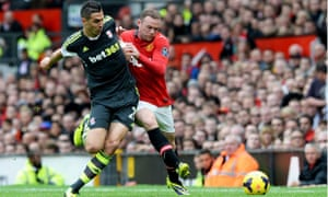 Manchester United's Wayne Rooney, right, and Stoke City's Geoff Cameron