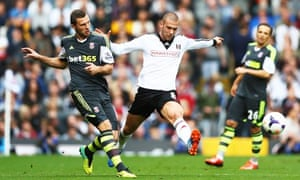 Stoke City's Erik Pieters, left, and Pajtim Kasami of Fulham in the Premier League match