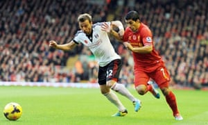 Liverpool's Luis Suarez right, scored the third goal against Fulham in the Premier League at Anfield