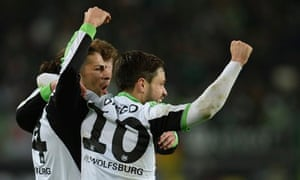 Wolfsburg celebrate a goal against Stuttgart