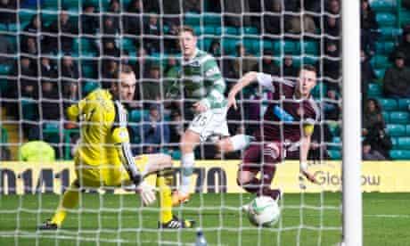 Celtic's Kris Commons, centre, scores against Hearts in the Scottish Premiership at Celtic Park