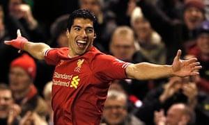 Liverpool's Suarez celebrates scoring a goal against Norwich