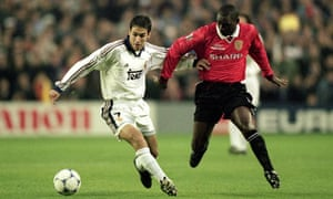 Raul of Real Madrid holds off Andy Cole