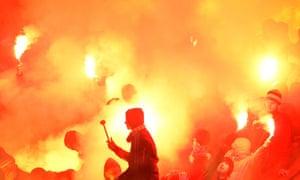 Zenit St Petersburg fans light flares during the Europa League match against Hajduk Split.