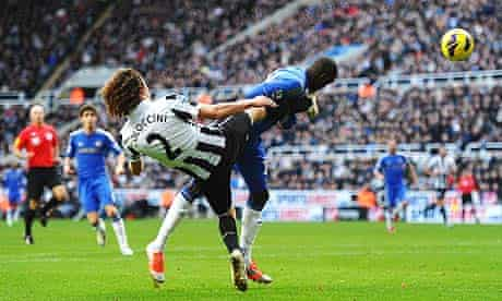Demba Ba of Chelsea is kicked in the face by Fabricio Coloccini of Newcastle United